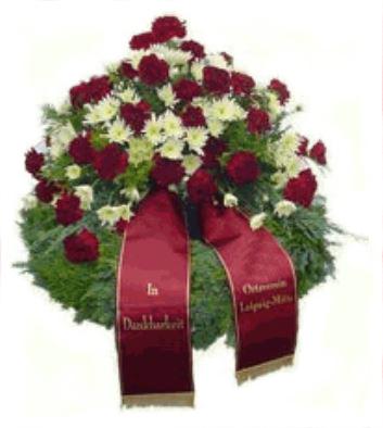 Blumengesteck mit bedruckterTrauerschleife. Gestaltet von den Floristen der Blumenhalle